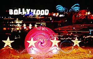 I chose this photo because it is multiple images of the theme camps that surrounded us in 2003, those are our stars, Bollywood was across the street, Eye of Gawd next door, etc., etc., etc